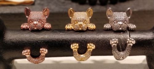 Diamond-set, dog-shaped, gold rings at JCK 2019.